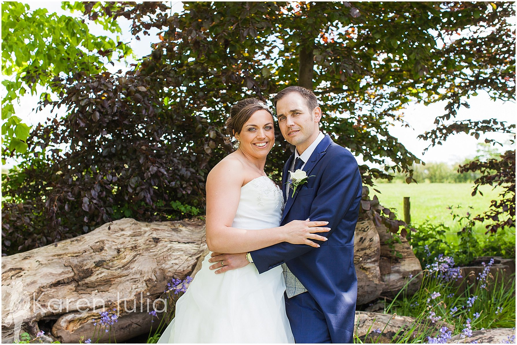 bride & groom with bluebells spring house hotel
