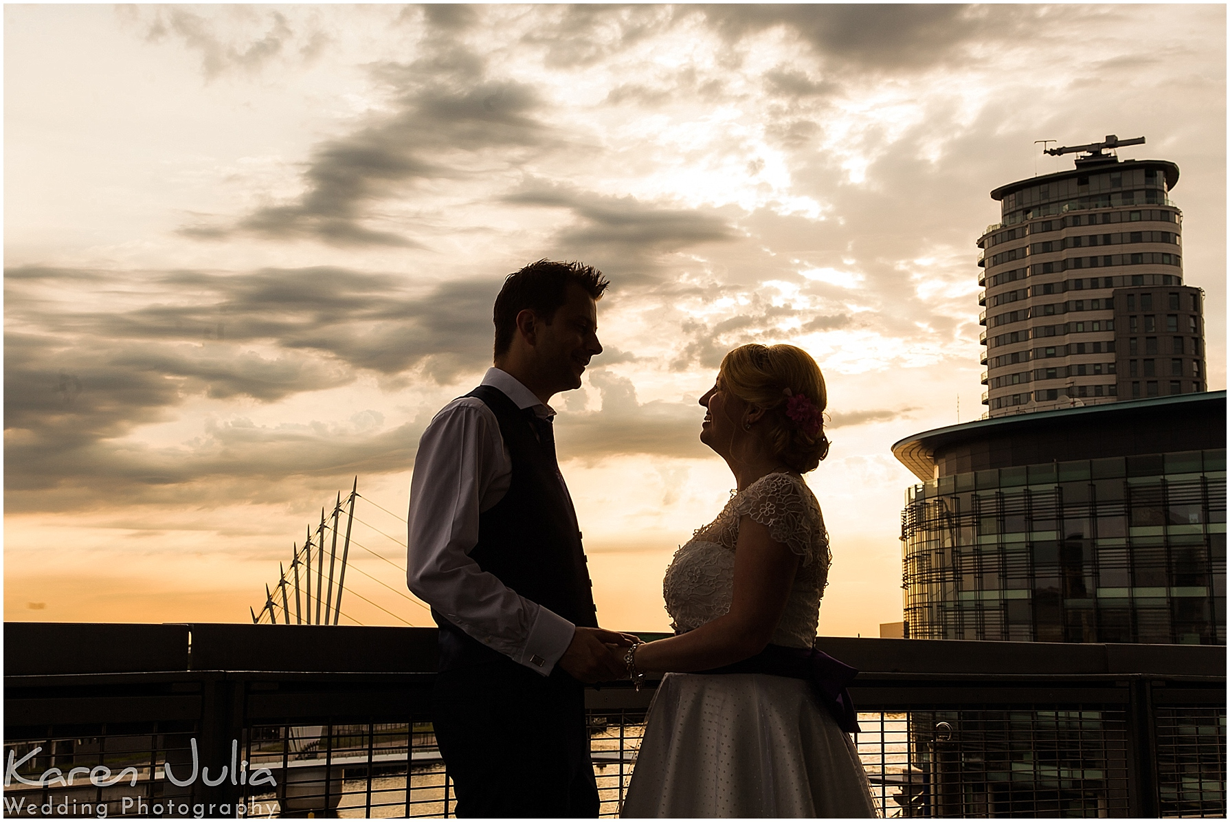 bride and groom sunset silhouette at lowry theatre
