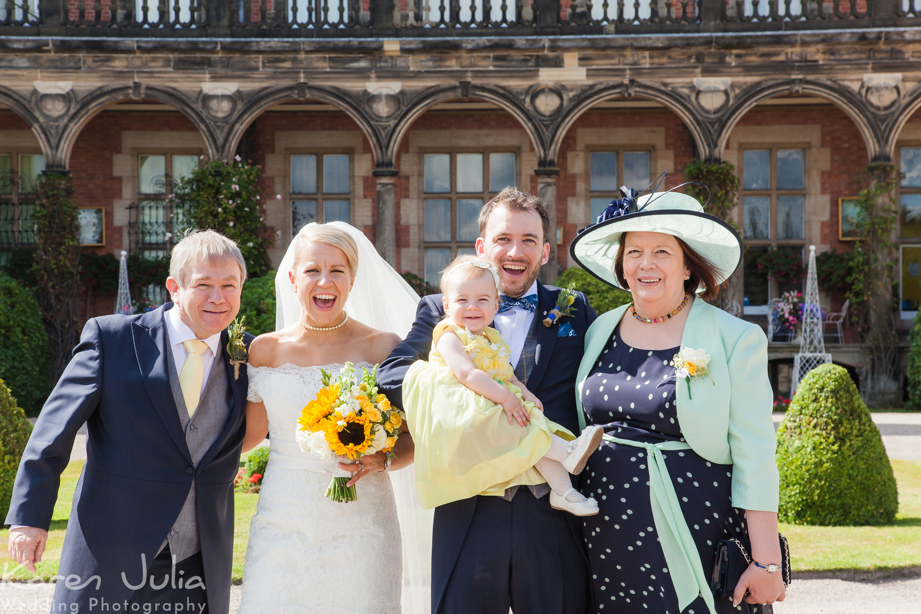 wedding group photo with young child at Capesthorne Hall