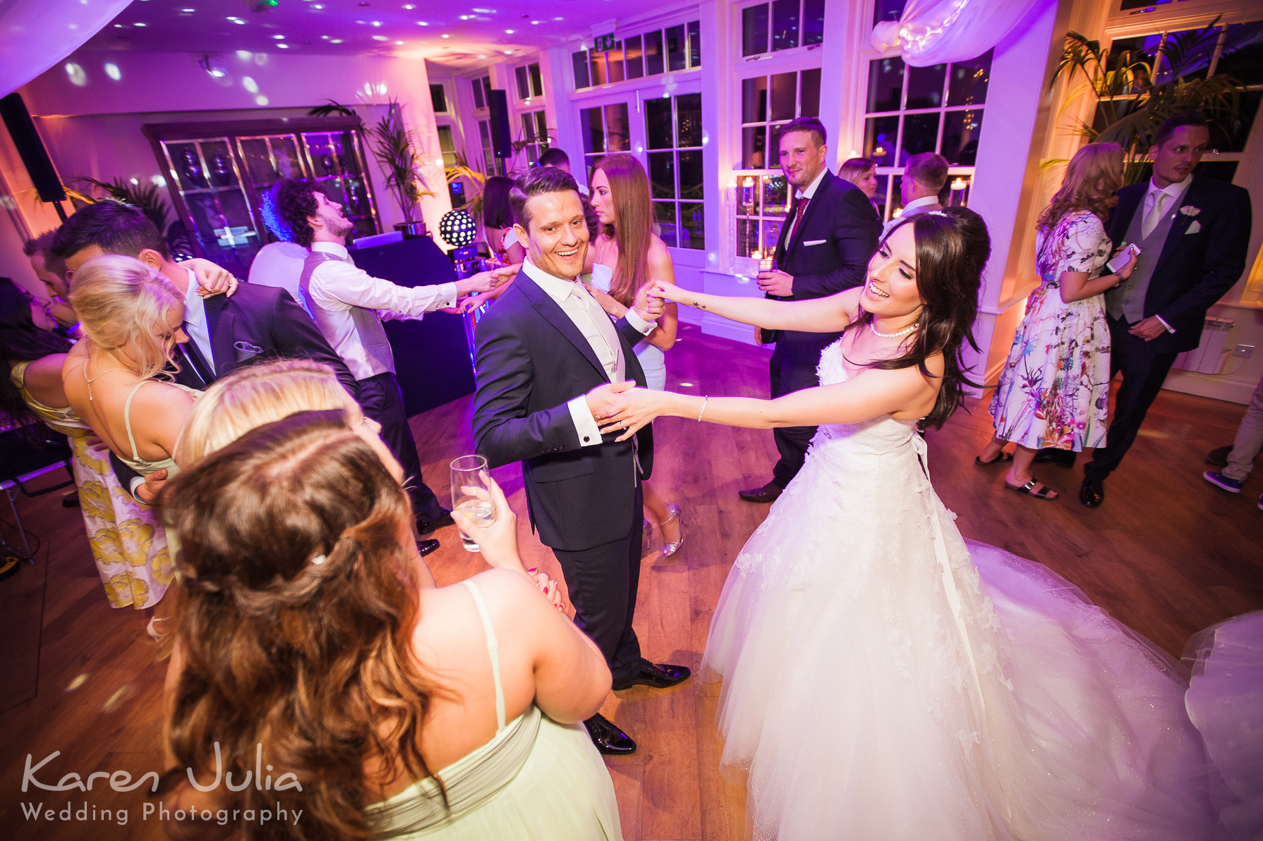bride and groom on dance floor at mutton hall