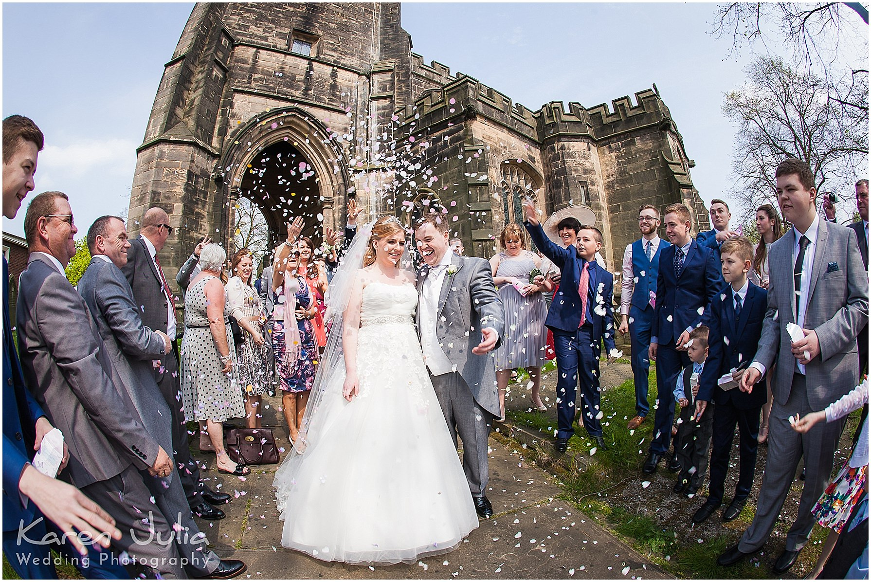 bride and groom showered in confetti outside st marys church